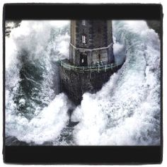 21 December 1989. gale force winds and huge waves of 20 to 30 metres high. Lighthouse keeper Théodore Malgorn  waiting to be rescued.   photographer Jean Guichard  took his world-famous shot as the wave smashed against the tower. Théodore Malgorn, rushed back inside just in time to safe his life.  Jean Guichard's 1989 dramatic storm photo shots earned him the World Press Photo award.