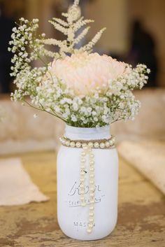 Centerpieces don't have to be expensive! DIY your reception centerpieces by painting mason jars   Kennedy Blue