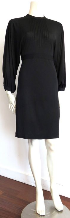1970's JEAN MUIR Pin-tucked LBD dress | From a collection of rare vintage day dresses at https://www.1stdibs.com/fashion/clothing/day-dresses/
