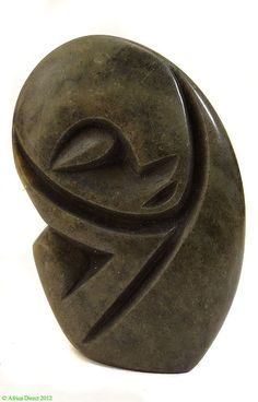 Shona Stone Peaceful/Sweet Face Zimbabwe African  Materials: Serpentine  Country of origin: Zimbabwe  Ethnic group: Shona  Approximate age: Contemporary