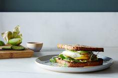 Monster Avocado Toast Sandwich | avocado, pesto, fried egg, spinach, mozzarella, tomatillo, & cucumber on toast