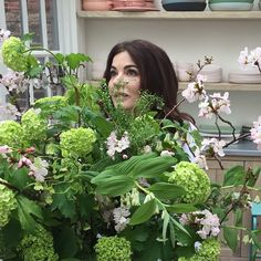 Being engulfed by flowers while gazing into middle distance during brief time-out during today's #SimplyNigella shoot. And now I must snap back into action! Snapped by @tw_makeup