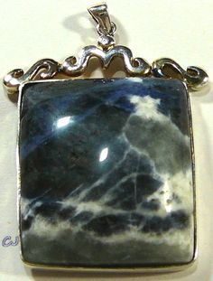 "ARTISAN DESIGN, BRAZILIAN SODALITE, RECTANGULAR CUT SEMI-PRECIOUS GEM PENDANT. 925 STERLING SILVER PENDANT. RECTANGULAR-SHAPED PENDANT ...CUSTOM MADE BY DESIGNERS. NATURAL, 100% GENUINE ELEGANT BRAZILIAN SODALITE. BEZEL SET IN AN CLASSIC SILVER DESIGN MEASURES: 2-1/4"" LONG HALLMARKED: .925 STERLING SILVER EXCELLENT CONDITION - www.etsy.com/shop/SylCameoJewelsStore"