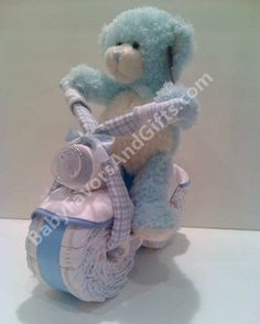 Unique Diaper Cakes-Centerpieces-Baby Shower gift ideas: Bear on Bicycle Diaper Cake Centerpiece Baby Showe. Boat Diaper Cake, Diaper Tricycle, Diaper Cupcakes, Diaper Motorcycle Cake, Diaper Bike, Blue Motorcycle, Cake Baby, Diaper Cake Centerpieces, Baby Shower Centerpieces