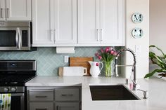 contemporary kitchen - glass herringbone subway backsplash