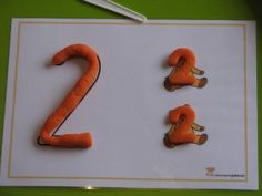Free Printable Number Play Dough Mats to use to learn about numbers and the concept of 'how many' while playing with play dough!