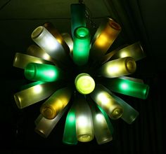 Recycled Wine Bottle Chandelier - This chandelier incorporates 35 used wine bottles and uses bulbs that are 12 volt, and only .018 amps each. The body of the chandelier is made from plumbing parts.