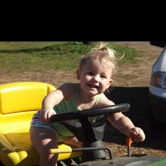 My niece Brylee hanging out on the john deer lawn mower! Gotta love that face!