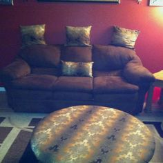 Coffee table made into an ottoman with pillows to match.