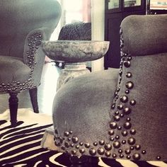Design created with upholstery tacks
