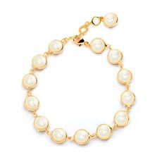 Syna 18 karat yellow gold 8 inch Chakra bracelet with 7mm mother-of-pearl discs.  Available for purchase online at www.leonardojewelers.com and  in our Red Bank, NJ and Elizabeth, NJ stores.