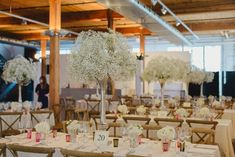 Elegant baby's breath centerpieces | Image by Emilie Iggiotti