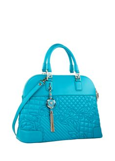 The turquoise Vanitas Athena bag adds a touch of glam to your everyday look. Make it yours.  #Versace #VersaceVanitasBag