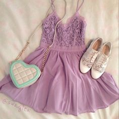 I don't really like the bag, and not even so sure about the dress, but I just LOVE brogues with a dress! Also, the lilac with the White is so delicate and pretty... Definitely trying that colour combo out.