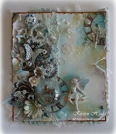 Mixed Media, using Tim Holtz gears, Prima products, old toys and parts from a sewing mac,hine.