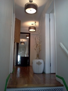 my  upstairs hallway before painting , but after new light fixtures