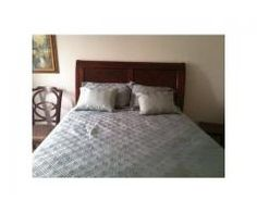 This Beautiful Cherry Bassett Queen Sleigh Bed & Armoire is gently used, bed has been slept in 6 times. I've had it for 4 years as a spare bedroom suite. I purchased this set for $3200 + $500 for the pillow top mattress. Unfortunately I'm moving and don't have room for it. My loss is your gain!  US$1,300