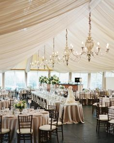 "Pinterest Board: Wedding Reception   ""The ceiling of the tent felt very high,"" says Lauren of her reception space in Newport, Rhode Island. The solution? ""We brought in chandeliers and swathed the beams in chiffon-muslin, which was beautiful."""