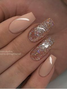 Amazing nude coffin shaped nails with glitter design!
