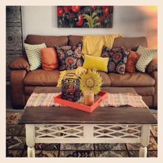 love the mixed pattern throws and the coffee table