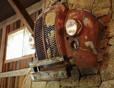 truck grille over mantel in barn conversion