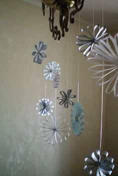 Love these delicate paper ornaments.