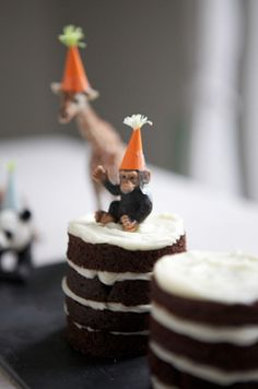 put party hats on ordinary toy animals for some whimsical cake toppers