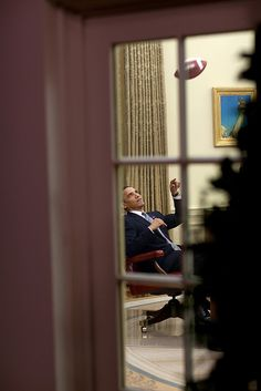 President Barack Obama plays with a football in the Oval Office, April  23, 2009. (Official White House Photo by Pete Souza