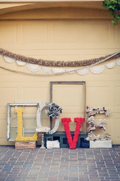 Letters are covered in Chenille yarn, newspaper, rose petals, and fabric+burlap