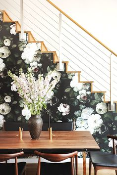 Wallpaper Accent Wall - Open dining space with a wooden table, midcentury modern chairs, large flowers, . - Wildas Wallpaper World
