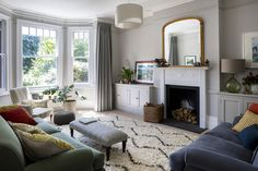 Farrow & Ball Purbeck Stone grey walls, bespoke cabinetry & curtains, Moroccan rug, traditional sofa and velvet cushions in the Sitt… Farrow And Ball Living Room, Living Room Carpet, Living Room Grey, Rugs In Living Room, Home And Living, Grey Living Room Curtains, Living Room With Bay Window, Living Room Decor Uk, Small Living