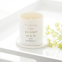 A beautiful scented glass candle, personalised with the message, Everything I am you helped me to be with three little hearts and a name. This beautiful hand poured candle makes a very special keepsake and would be perfect for Mothers Day or a Birthday gift.  Choose your candle colour and scent from:  White - fresh and floral sweet pea & white jasmine to uplift and add an air of luxury. Black - luxurious vanilla blended with soft amber and velvety musk, an opulent and rich scent.  Pink, l...