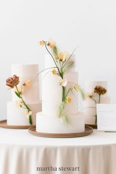 Three smooth, white, multi-tier cakes from Revelry Cakes were decorated with sophisticated, long-stemmed blooms—a nod to the idea that when you're hosting fewer guests, you can splurge on your favorite elements (like dessert!). #weddingideas #wedding #marthstewartwedding #weddingplanning #weddingchecklist White Wedding Cakes, Wedding Cake Rustic, Floral Wedding, Wedding Flowers, Dessert Bar Wedding, Modern Wedding Inspiration, Shower Inspiration, Wedding Ideas, Martha Stewart Weddings