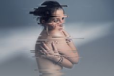 Autoportrait from Anastasia Vervueren. Nude studio portrait with sci-fi post-prod on photoshop. Bleu background.