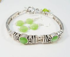Ladies Bracelet  Green and Silver Cateye Beads by babbleon on Etsy, $20.00