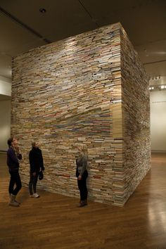 """The Fourth Thousand Years"" by Adam Bateman- A 14-foot tall, 83,000-pound sculpture took about 600 hours. The books were carefully stacked and are held by gravity only."