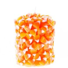 "Nothing says fall like candy corn! Our clever 3"" x 4"" candy corn scented pillar candle is a perfect autumn decoration, and a great Halloween or Thanksgiving home accent, too."