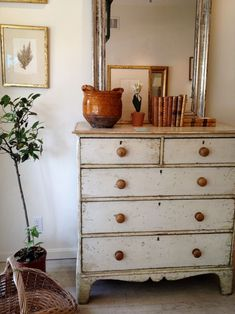 Patina white finish with natural wooden knobs. (via Velvet and Linen)