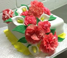 Beautiful handcrafted edible flowers make this cake look pretty and it tastes delicious too
