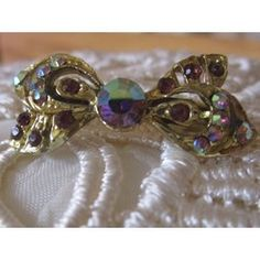 """New Listing Started vintage goldtone small bow brooch with rhinestones/red stones 1.25""""across £2.35"""
