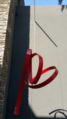 """Abstract sculpture called"""" Live Wire"""" turns in the wind...."""