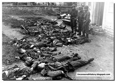 SS gauards shot by American soldiers at Dachau