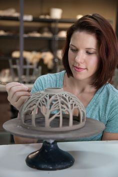 Annie Quigley of Quigley Ceramics carving a Pendant Lamp Shade