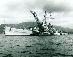 80-G-417996. USS Juneau (CLAA-119). Receives ammunition and fuel at Sasebo, Japan, on 6 July 1950. Flagship of Rear Admiral John M. Higgins, Commander, Task Group 96.5, Juneau actively patrolled and bombarded along the Korean east coast from 28 June to 5 July 1950. She was the first U.S. Navy cruiser to see combat action during the Korean War. Note Japanese floating crane alongside. Official U.S. Navy Photograph, now in the collections of the National Archives.
