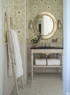 A charming wallpaper warms up a bathroom | archdigest.com