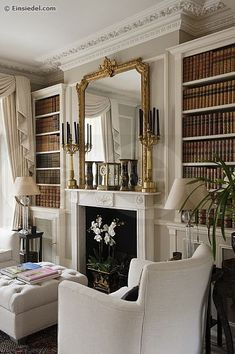 white fireplace + gold mirror
