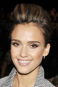 At the Diane von Furstenberg show, Jessica Alba sported some major volume with a pompadour/French twist combo. To get height like hers, leave the front section of hair out while you create your French twist. When you're finished, take the front section of hair, tease it, and then secure in place with bobby pins.