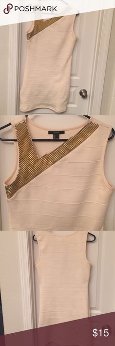 Cream and Gold Bandage Dress Body con bandage dress. Cream with gold accenting along the asymmetrical neckline. Stretchy material, and think so it's very flattering and forgiving! Forever 21 Dresses Mini
