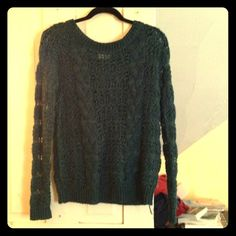 Semi-open Knit Dark Teal Sweater Soft, dark teal/emerald green sweater.  Has stripes of open/closed knitting, so not the warmest come winter unless you wear a shirt underneath.  Gorgeous color, excellent styled with dark pants and brassy gold accessories. Pins and Needles (UO) Sweaters