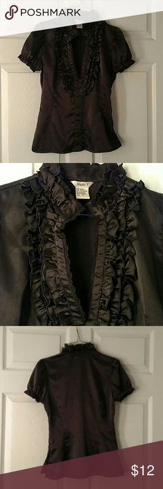 Black Maurices Studio Y  Satin Ruffled Shirt small Nice black ruffled satin shirt from Maurice's.  Great condition but not perfect. There are a few tiny picks in the fabric on the back just under the collar ruffle.  See picture four. Hardly noticeable.  I didn't find any other issues. Cute shirt but not much stretch. It fits small to extra small.  There is a zipper on the side to make it easier to get on and off since it is a fitted style shirt. Studio Y Tops Blouses